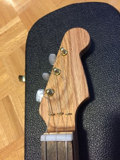 Brass tuners on headstock